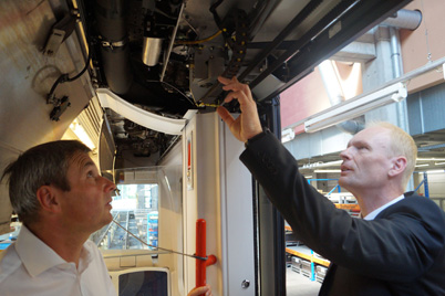 VAG system technician Robert Meier and igus® expert Werner Pecher test a door system with chainflex® cables and e-chain®.